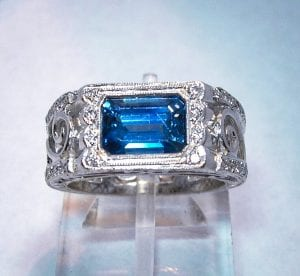 Emerald cut wide sapphire white gold band ring