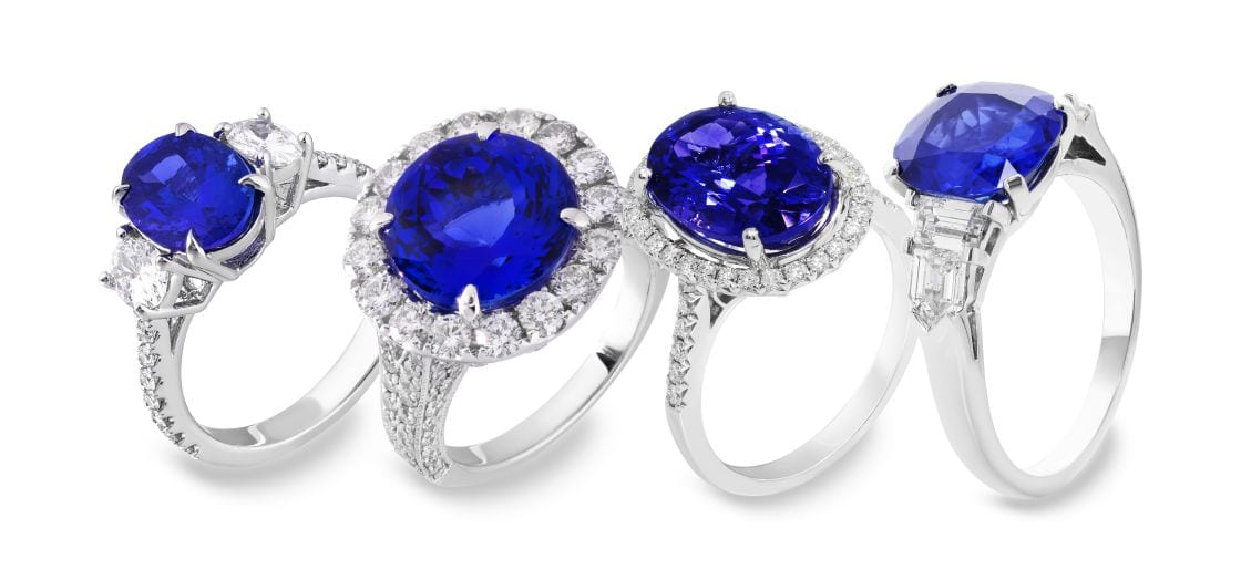 Four bright blue sapphire and diamond rings
