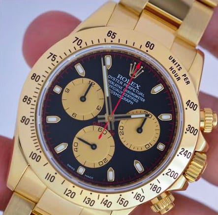 Gold Rolex Oyster Perpetual Watch with White Face and Leather Strap