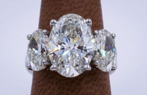 Three stone oval diamond Graff engagement ring