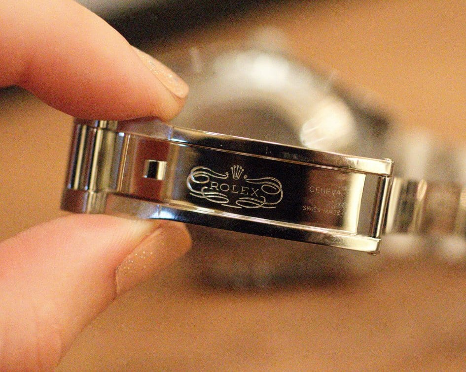Rolex logo inside of the watch band