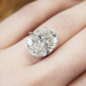Large oval diamond engagement ring on finger